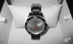 Men's Tissot watch. White face with Day/ Date.
