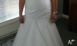 Brand new gown never worn. Has been custom made and is