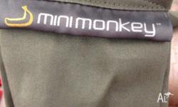 A mini monkey baby sling is up for a quick sale. It has