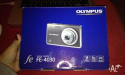 This is a bran new Olympus digital camera that is still