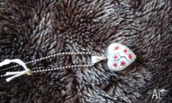 Heart pendant and silver chain