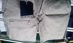 BRAND NEW SHORTS Size 87R, above knee shorts Khaki