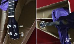 Brand New Soprano Ukulele in Purple color with Bag and