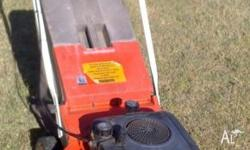 This is a Flymo mower manufactured in the UK. The