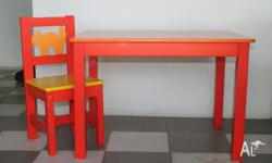 Bright orange and yellow child's table and chair set.