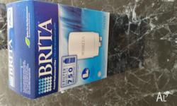 Offering a BRITA on tap water filter. NEW, in box.