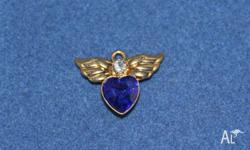Small Blue heart shaped stone in center with gold wings
