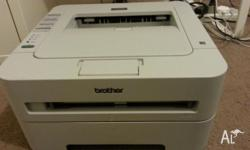 A 95% new Brother HL-2130 Laser Printer with one new