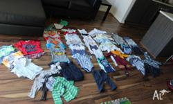 An assortment of baby clothes ranging from size 0-1.