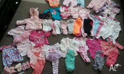 Approximately 50 assorted items of baby girl clothes