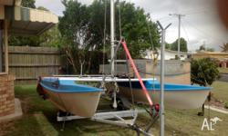 Calypso 14 ft twin hull with mainsail and headsail.