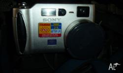 sony cyber-shot camera with software and 3 batterys.