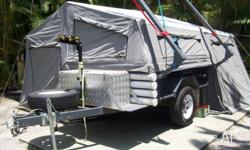 This trailer is ready to go with extra water tank for