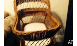 Cane bassinet in excellent condition has four wheels so
