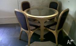 Cane dining suite including 4 upholstered chairs. Glass