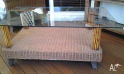 THICK GLASS TOP CANE COFFEE TABLE WITH SHELF. USED.