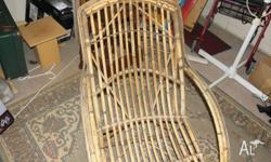 Vintage cane lounge,strong & sturdy.Dimensions 185cm