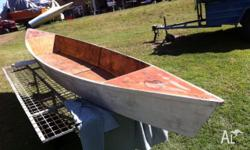 Well built wooden canoe, joints have been fibreglassed,