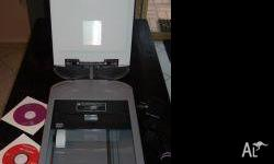 For Sale is a used CANOSCAN D125OU2F flatbed scanner