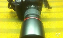 This Canon EOS D60 comes with a Canon EF 135mm 1:2 L