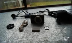 Canon Camera, battery included, charger, memory card