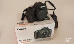 Canon 500D for sale. It has hardly been used (shutter
