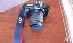 Canon EOS650 camera. With 28-90mm lens. + lens hood.