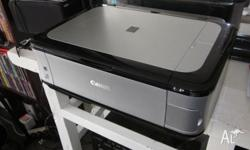 Canon Pixma MP560 multipurpose printer with scanner,