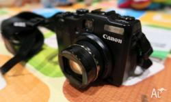 For Sale: - Canon Powershot G12 Camera and Lanyard -