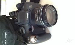 As new Canon PowerShot for sale. In immaculate