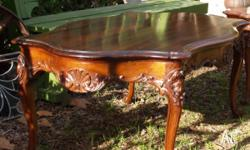 This is a carved French style mahogany coffee table