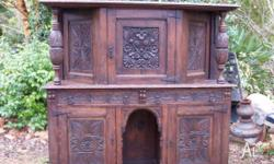 This is a heavily carved English oak early 1900's court