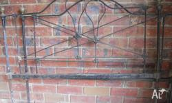 Late 1890s cast iron bed with brass knobs. Larger then