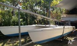 Catamaran in good condition. Trailer, boat and sails in