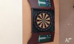 Very cheap pub quality dartboard. Darts included. Used