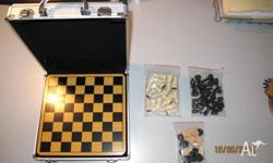 Chess and Checkers Game Set as per photo. Email: