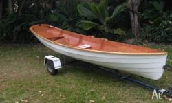 Timber rowing dinghy, classic clinker design but built