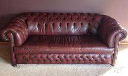 2.5 seater burgundy Chesterfield Couch for sale.