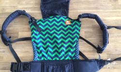 Navy and green chevron Tula baby carrier with
