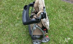 Used child stroller for sale, good condition for age.