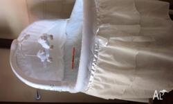 Childcare bassinet, white with mobile. Good condition