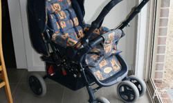Beautiful blue pram with pictures of teddies. Can