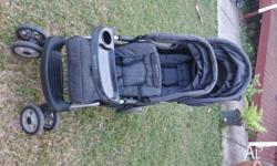 I have a black childcare two up tandem stroller for