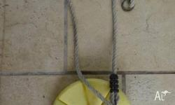Yellow hard plastic sit on swing. Great for all ages,