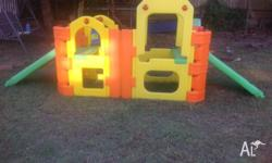 In good condition. Outdoor childrens playset with a