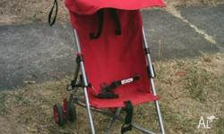 Red fold up style stroller, lightweight, duel wheels,