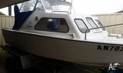 Chinook 16 Foot Half cabin cruiser fiber glass 70 hp