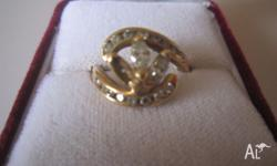 18ct gold featuring 2 Marquise diamonds and 8 small