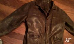 Old style, heavy leather jacket. Thick, good, strong