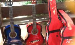 2xclasical guitars with cases as new cost $140.00 each